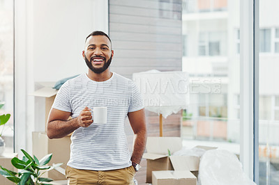Buy stock photo Portrait of a young man taking a break while moving house