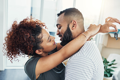 Buy stock photo Shot of a young couple moving in to their new home