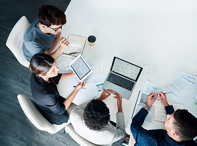 Buy stock photo High angle shot of a group of businesspeople having a meeting in a modern office