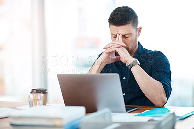 Buy stock photo Shot of a businessman experiencing stress while working in a modern office