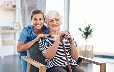 Buy stock photo Shot of a senior woman with a walking stick being cared for a nurse