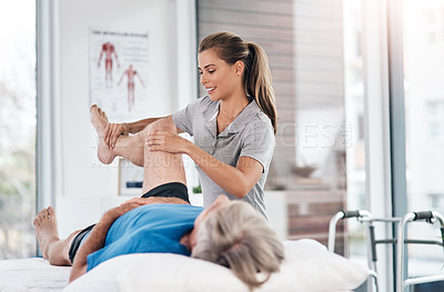 Buy stock photo Shot of a senior man being treated by a physiotherapist