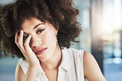Buy stock photo Cropped shot of a stressed young businesswoman seated at her desk while being in deep thought in the office during the day
