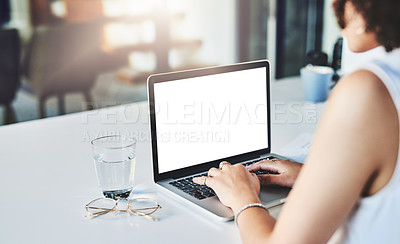 Buy stock photo Over the shoulder shot of an unrecognizable businesswoman working on her laptop while being seated inside of the office
