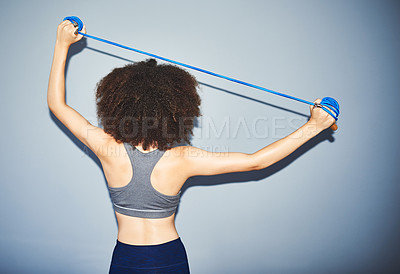 Buy stock photo Studio shot of an attractive young female athlete posing against a grey background