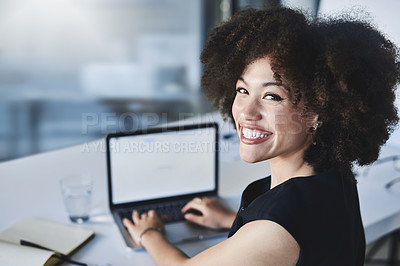 Buy stock photo Portrait of a beautiful young businesswoman working on a laptop in her office
