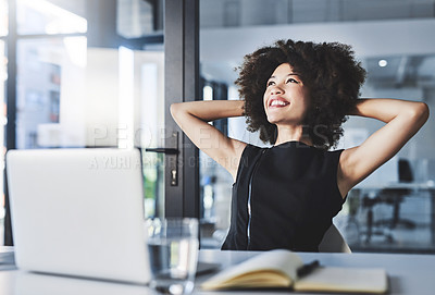 Buy stock photo Shot of a beautiful young businesswoman sitting back and relaxing with her hands behind her head in her office