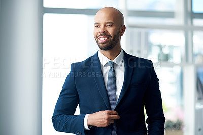 Buy stock photo Shot of cheerful young businessman in his office