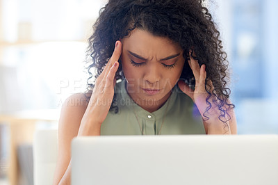 Buy stock photo Cropped shot of a young businesswoman looking stressed while working at her desk in the office