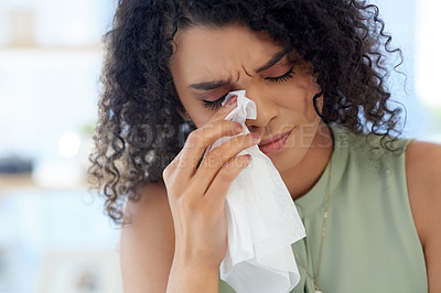 Buy stock photo Cropped shot of a young businesswoman crying while working at her desk in the office