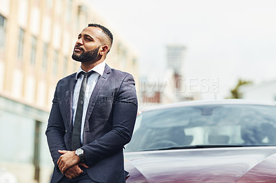 Buy stock photo Shot of a handsome businessman out in the city