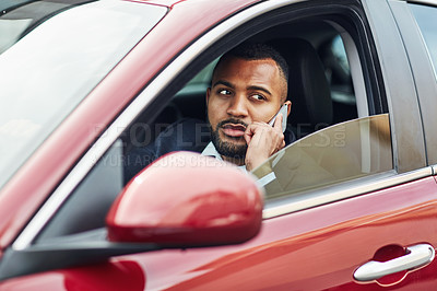 Buy stock photo Cropped shot of a man talking on his cellphone while driving a car