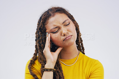 Buy stock photo Studio shot of a young woman looking thoughtful against a gray background