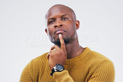 Buy stock photo Studio shot of a man looking thoughtful against a gray background