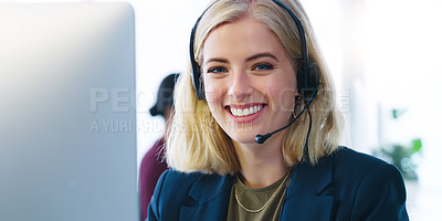 Buy stock photo Cropped shot of a cheerful young businesswoman wearing a headset while talking to a client over the phone inside of the office