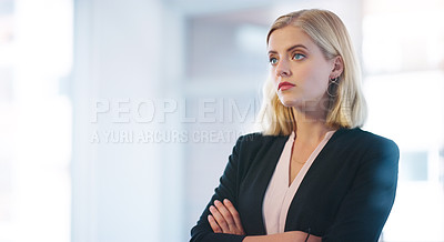 Buy stock photo Shot of a confident young businesswoman standing with her arms folded inside of the office