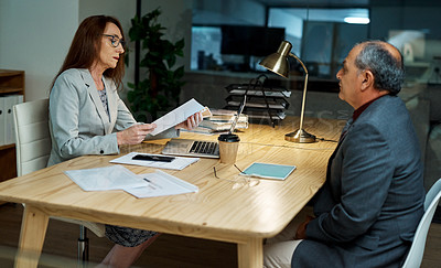 Buy stock photo Shot of a mature businesswoman meeting with a businessman in an office