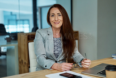 Buy stock photo Portrait of a mature businesswoman working in an office at night