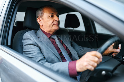 Buy stock photo Shot of a mature businessman driving a car