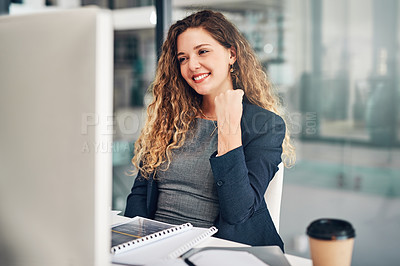 Buy stock photo Shot of a young businesswoman cheering while working on a computer in an office