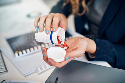 Buy stock photo Closeup shot of a businesswoman taking medication in an office