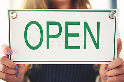 Buy stock photo Cropped shot of a woman hanging up an open sign in her her store