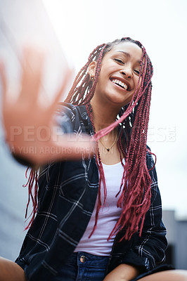 Buy stock photo Cropped portrait of an attractive young woman blocking being photographed with her hand while sitting outdoors