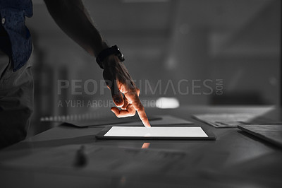 Buy stock photo Cropped shot of an unrecognizable person's businessman's hand using a tablet while working late at night in the office