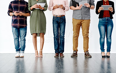 Buy stock photo Shot of unrecognizable businesspeople standing in line and preparing for an interview against a white background