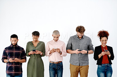 Buy stock photo Shot of a group of young businesspeople standing in line and preparing for an interview against a white background