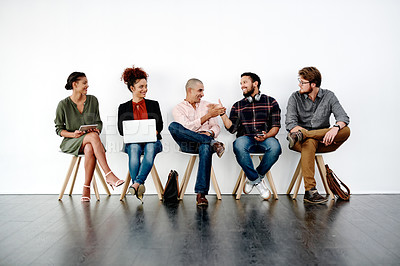 Buy stock photo Full length shot of young businesspeople sitting down and preparing for their interviews against a white background