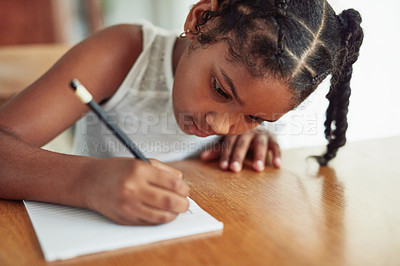 Buy stock photo Cropped shot of a young girl doing homework at home