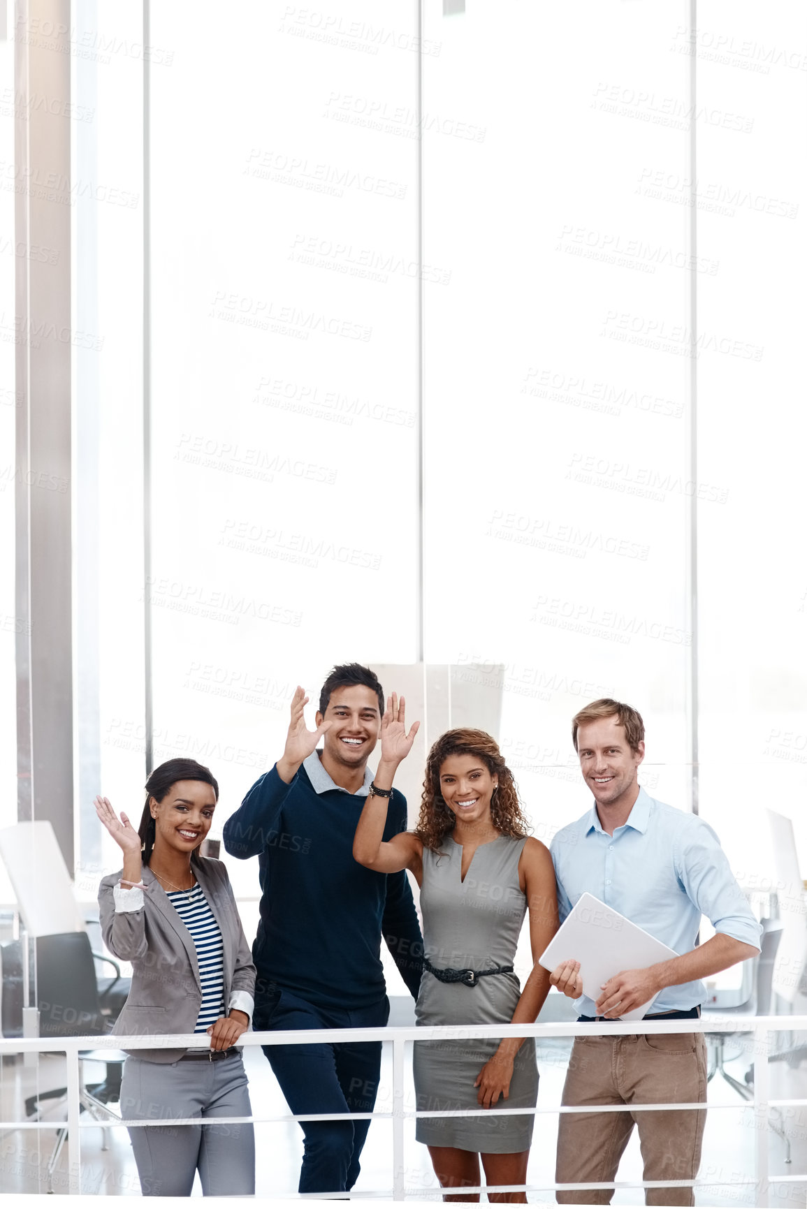 Buy stock photo Shot of a diverse group of colleagues waving at the camera with their arm raised at the office