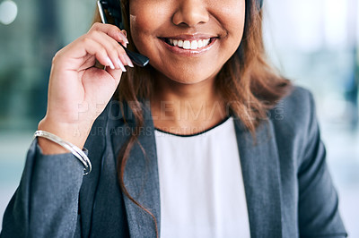 Buy stock photo Cropped shot of a confident young woman using a headset in a modern office