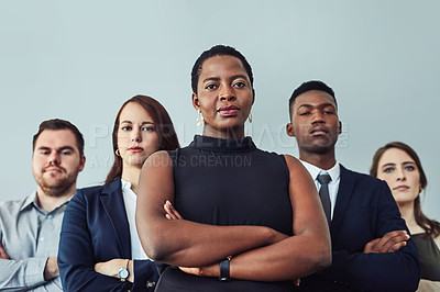 Buy stock photo Studio portrait of a group of confident young businesspeople standing together against a grey background