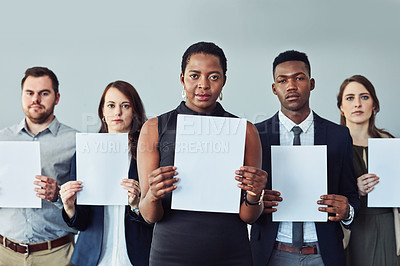 Buy stock photo Studio shot of a group of businesspeople holding blank signs against a grey background
