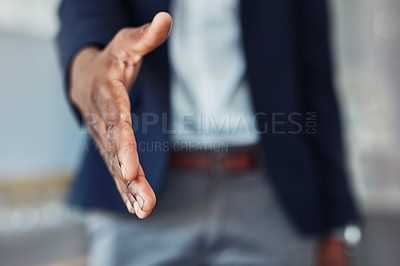 Buy stock photo Cropped shot of an unrecognizable businessman extending his arm for a handshake