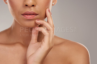 Buy stock photo Studio shot of an unrecognizable young woman posing against a grey background