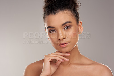 Buy stock photo Studio portrait of a beautiful young woman posing against a grey background