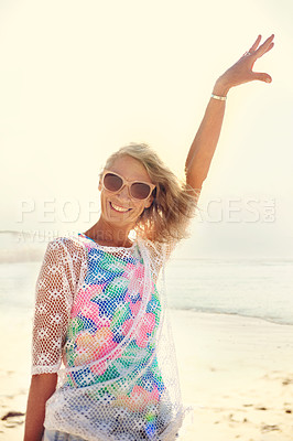 Buy stock photo Cropped shot of an attractive senior woman enjoying her day out at the beach