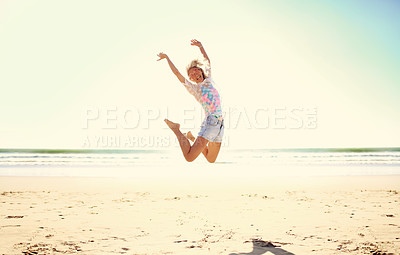 Buy stock photo Full length shot of an attractive senior woman enjoying her day out at the beach
