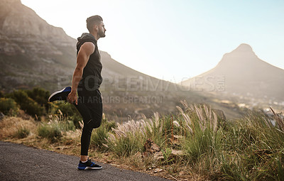 Buy stock photo Shot of a sporty young man exercising outdoors
