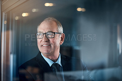 Buy stock photo Shot of a mature businessman looking thoughtful while standing in an office