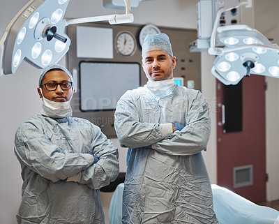 Buy stock photo Portrait of two confident surgeons working together in an operating room