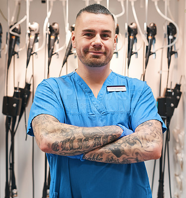 Buy stock photo Portrait of a medical diagnostic specialist standing with his arms folded with medical equipment in the background inside of a hospital