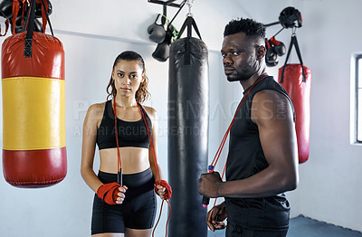 Buy stock photo Portrait of two young sportspeople at the gym