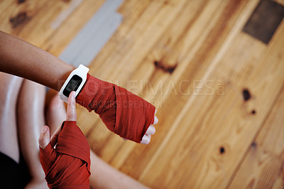 Buy stock photo Shot of an unrecognizable sportswoman checking the time on her sports watch at the gym