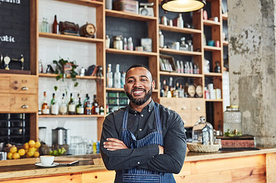 Buy stock photo Portrait of a shop owner standing with his arms crossed in his cafe