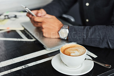 Buy stock photo Cropped shot of an unrecognizable man having coffee at a coffee shop