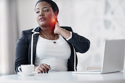 Buy stock photo Cropped shot of an attractive young businesswoman rubbing her neck in pain while working in the office